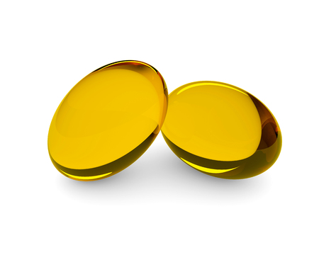 lying in: 3d oil supplements in soft gel capsules lying on desk Stock Photo