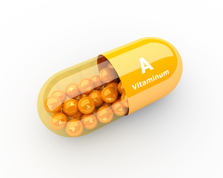 overdose: 3d vitamin A capsule lying on desk