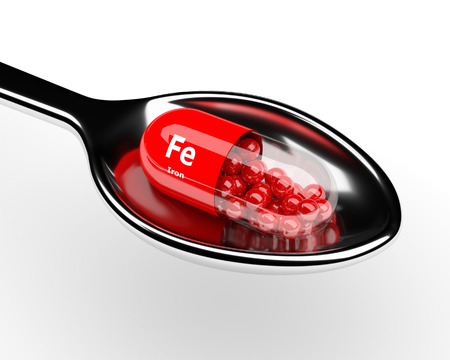 granules: 3d iron pill on spoon over white background