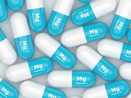 magnesium: 3d magnesium pills lying on white table Stock Photo