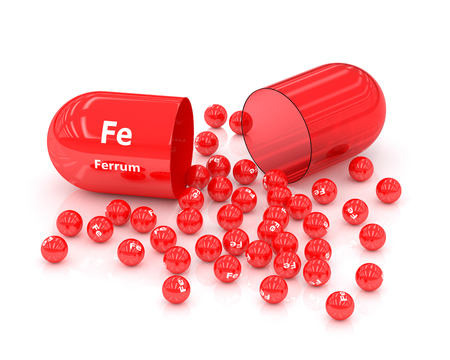 supplements: 3d rendered iron Fe pill over white background. Concept of dietary supplements