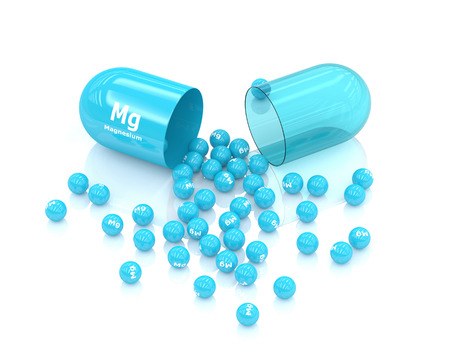 magnesium: 3d rendered magnesium Mg pill over white background. Concept of dietary supplements