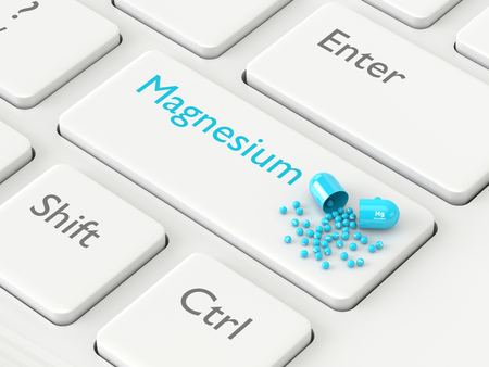 magnesium: 3d rendered magnesium Mg pill lying on keyboard. Concept of dietary supplements