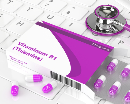 vitamin pills: 3d rendering of B1 vitamin pills lying with stethoscope on computer keyboard