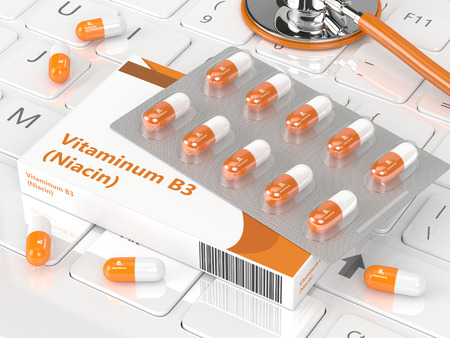 nicotinic: 3d rendering of vitamin B3 pills with stethoscope and keyboard Stock Photo