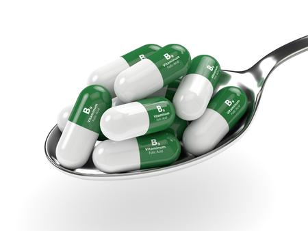 3D-Darstellung von B9 Folsäure Pillen auf Löffel isoliert über weißem Hintergrund Standard-Bild - 80695920
