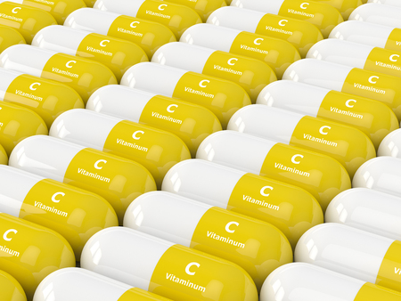 dietary: 3d render of vitamin C pills in row. Concept of dietary supplements