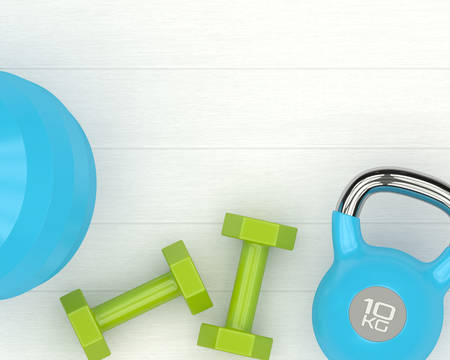3d rendering of dumbbells, kettlebell and fitness ball lying on wooden desk with place for text