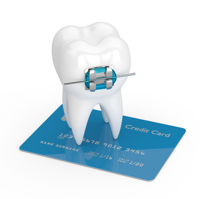 3d render of tooth with brace and credit card isolated over white background Stock Photo