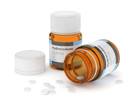 3d render of hydrocodone bottles with pills. Analgesic organic chemical compound concept.