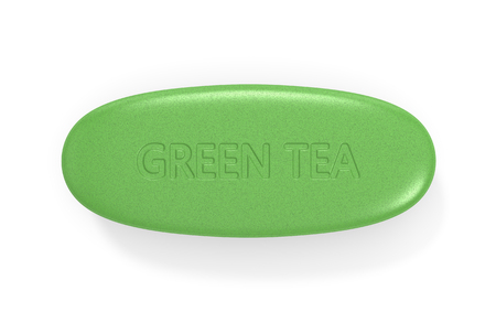 3d render of green tea pill isolated over white background Standard-Bild