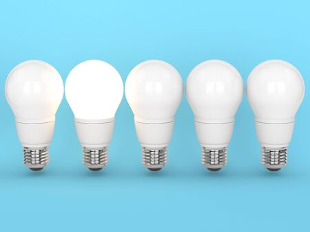 3d render of light bulbs with one lighting standing on blue background