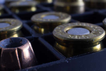 9mm ammo: Bullet Cartridges in Holder Stock Photo