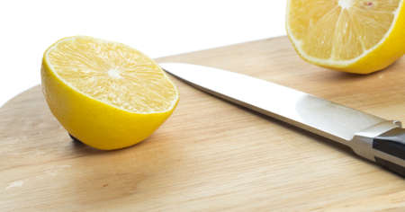 Sliced fresh lemon over chopping board