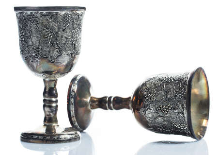 Old wine goblets on white background