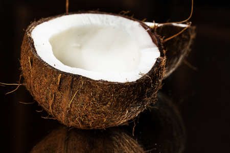 Close up of fresh coconut over dark background