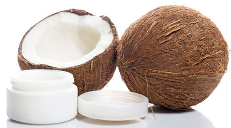 Coconut and moisturizer cream on white background