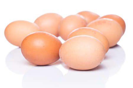 Brown eggs on white background Stock Photo