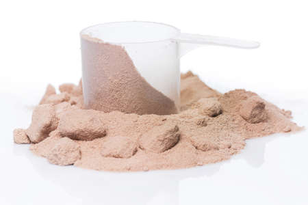 Whey protein powder and scoop