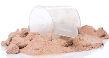 whey: Whey protein powder and scoop