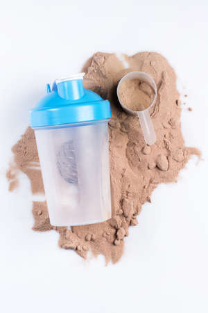 Shaker and protein powder on white background photo