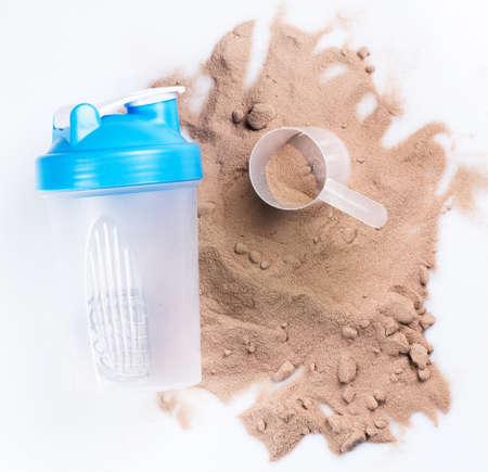 Shaker and protein powder on white background Foto de archivo
