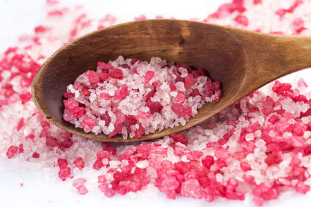 Wooden scoop with red sea salt for spa Stock Photo