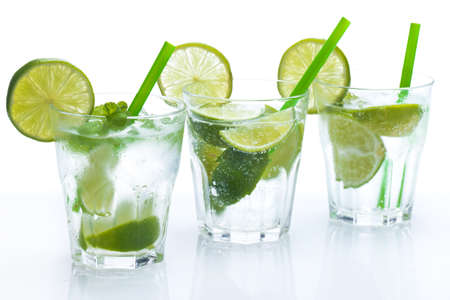 Fresh drink with lime and mint on white background Banco de Imagens - 24886136