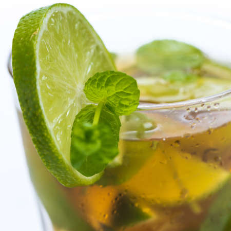 Glass of fresh ice tea with lime Stock Photo - 24886170