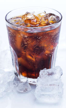 Glass of fresh coke with ice