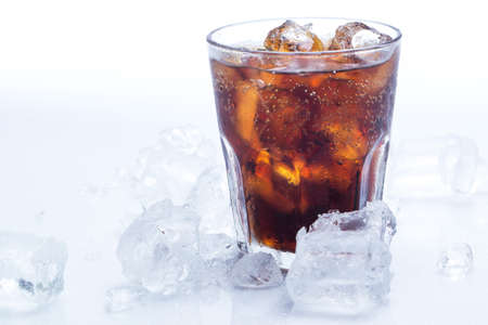 Glass of fresh coke with ice photo