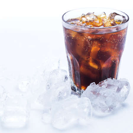 coke: Glass of fresh coke with ice