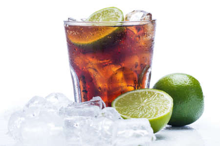 Fresh Fresh cocktail with cola drink and lime fruit