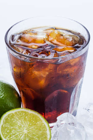 Fresh Fresh cocktail with cola drink and lime fruit photo