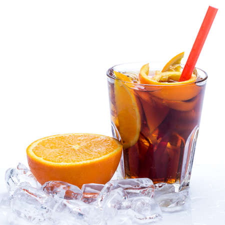 Cold cocktail with orange fruit over white background