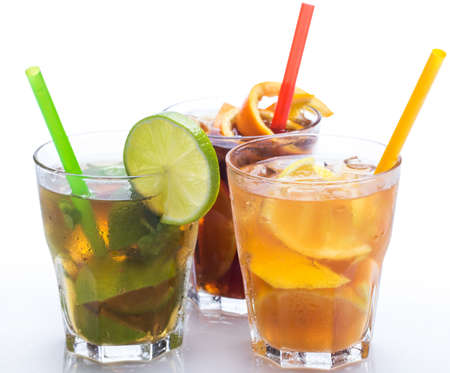 Glasses of cocktails with different citrus fruits