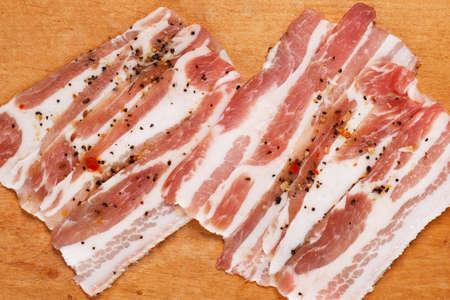 Fresh bacon on wooden board photo