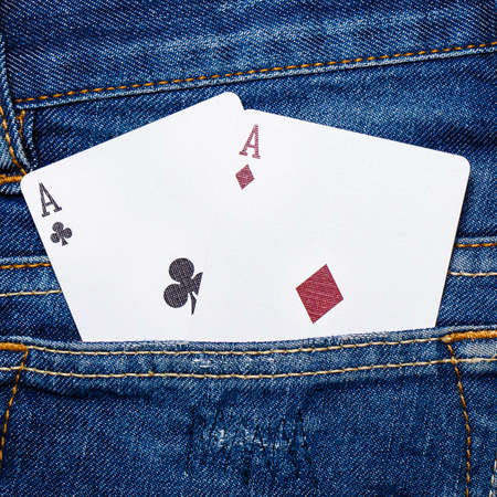 playing cards in jeans pocket photo