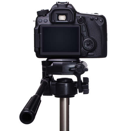 DSLR camera on tripod over white background