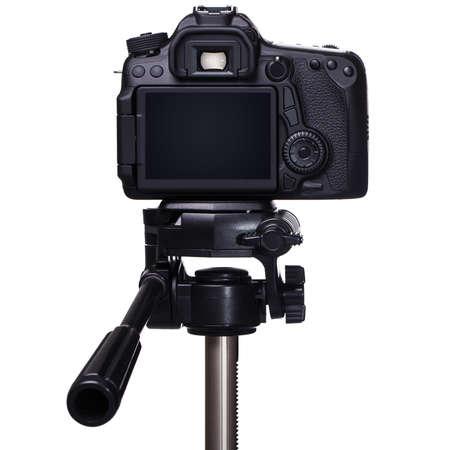 DSLR camera on tripod over white background