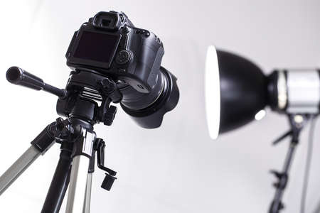 DSLR camera on tripod in the studio