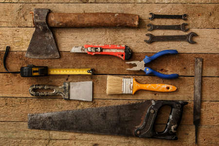 snips: Different industrial tools over wooden surface