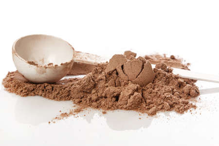 casein: Close up of protein powder and scoop Stock Photo