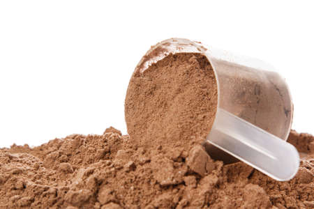 Close up of protein powder and scoop Imagens