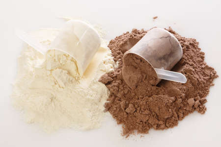 Close up of protein powder and scoops Imagens