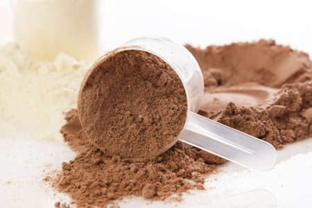 chocolate powder: Close up of protein powder and scoops Stock Photo