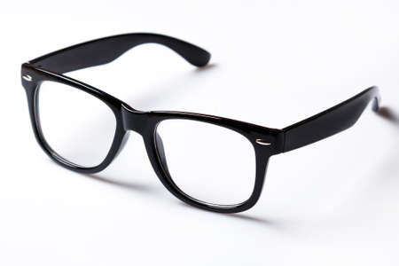 Eyeglasses with black rim over white background