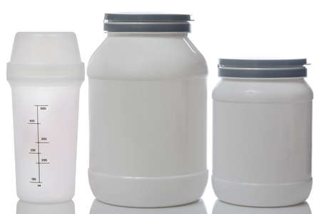 Jars with food supplements and shaker photo