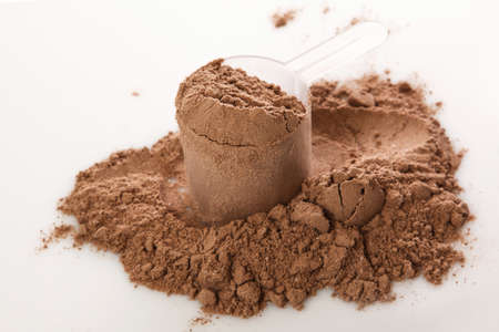 Close up de polvo de proteína y cuchara Foto de archivo - 34971311