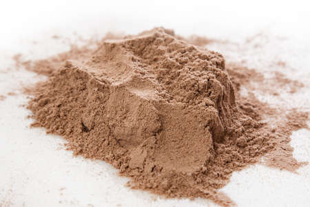 Close up of protein powder and scoop photo